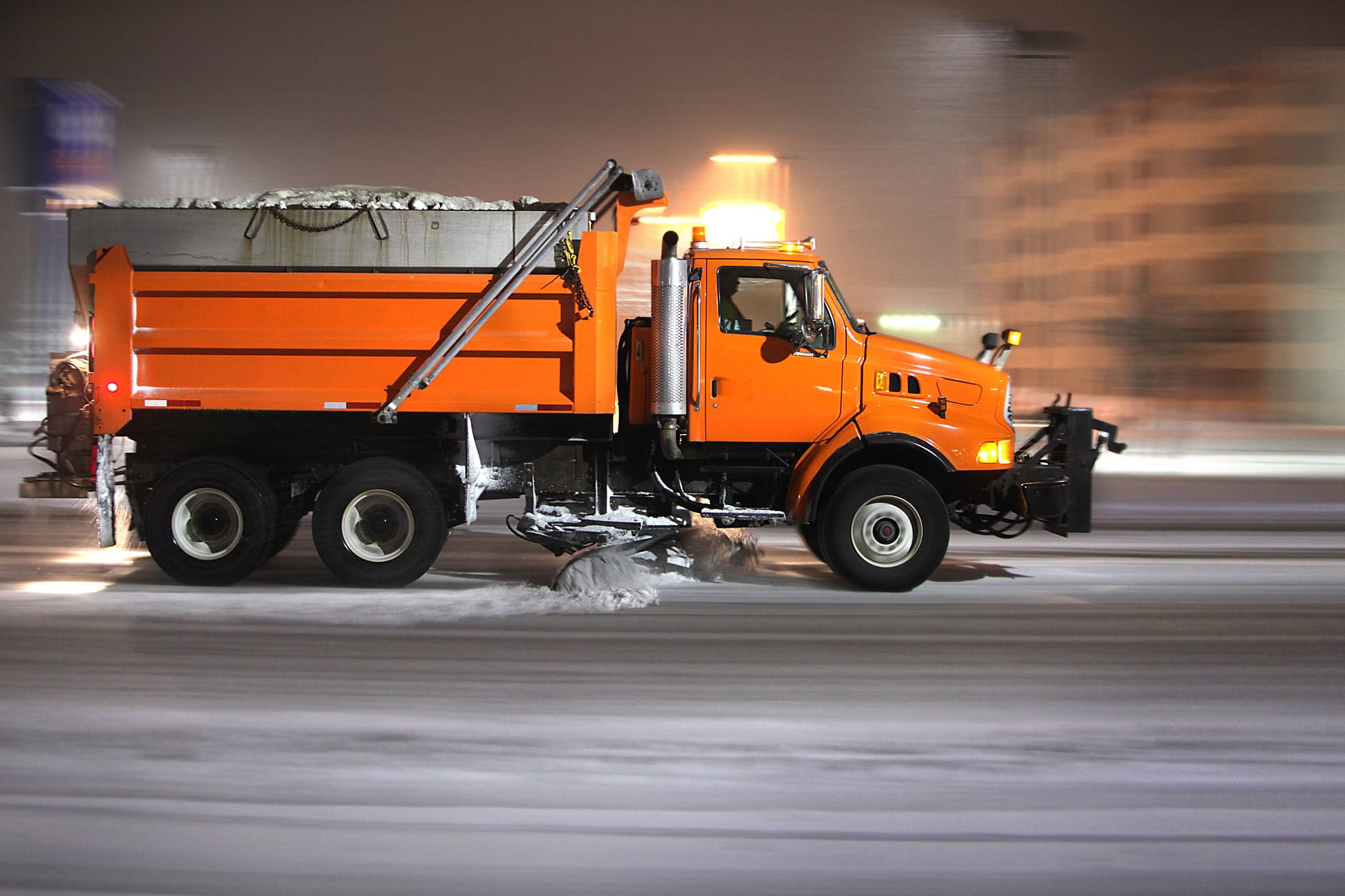 truck plowing snow from roads
